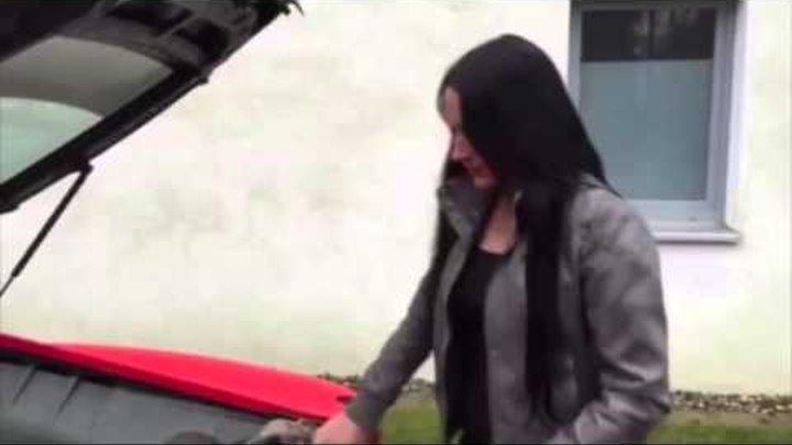 Stupid rich girl burns her purse on Ferrari exhaust