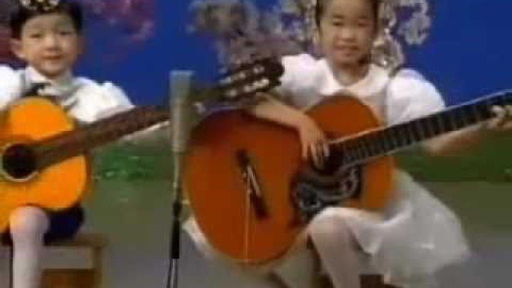 [гитары] «Бей, барабан!» {Музыка КНДР}