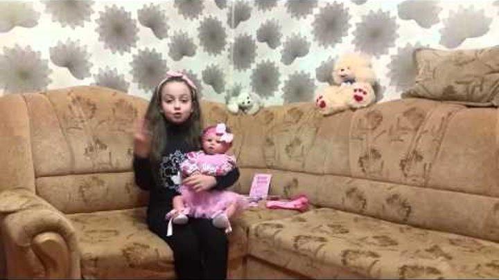 Кукла Реборн девочка с розовым цветочком