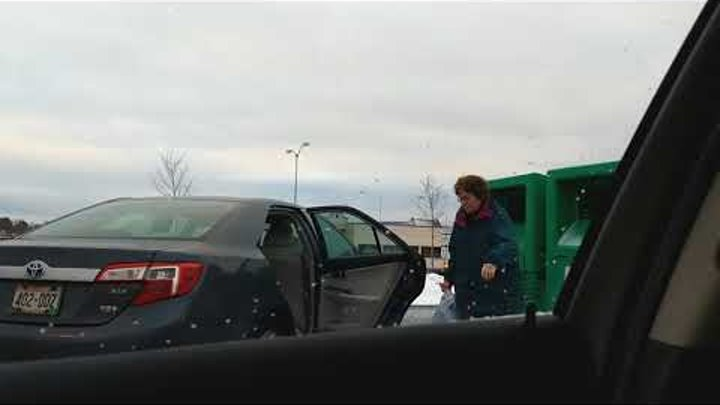 Women caught on camera stealing from donation bin.