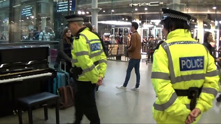 POLICE OFFICERS ENTERTAIN PLAYING BOOGIE WOOGIE PIANO PHANDOM
