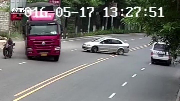 Motorcyclist in narrow escape as truck overturns