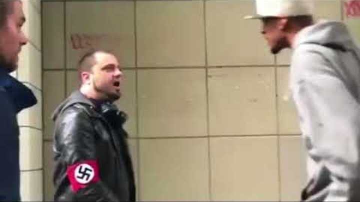 Man wearing Nazi armband gets knocked out with one punch...