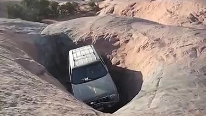 Jeep Grand Cherokee getting stuck in the hot tub. (Moab, UT)