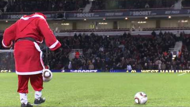 Football Freestyler Jeremy Lynch as Santa Claus performing his soccer skills at West Ham v Chelsea