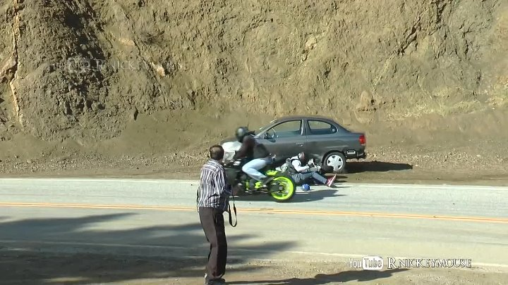 Motorcycle Slides Into Parked Car - Target Fixation