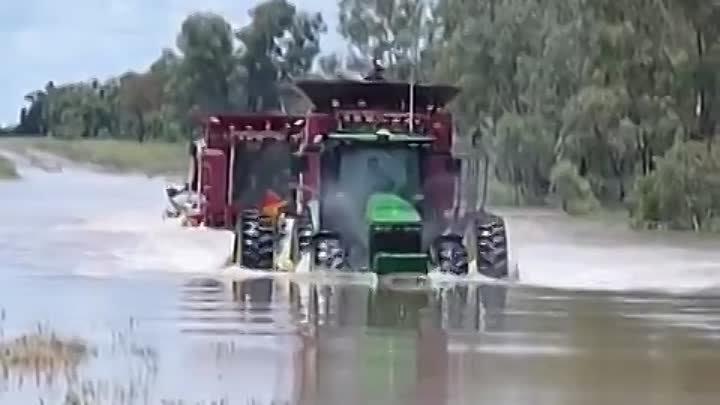 john deere and two case headers swimming