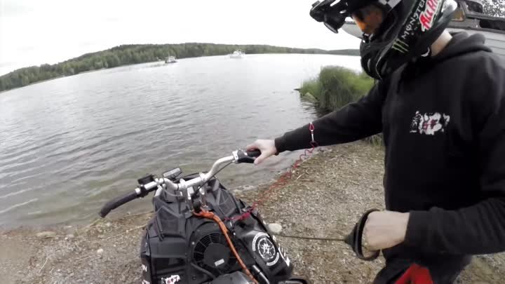 Snowmobile wheelies on water