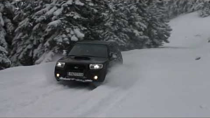 Subaru Forester playing in snow