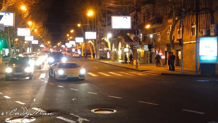 Yellow Lamborghini Aventador cruising around the town