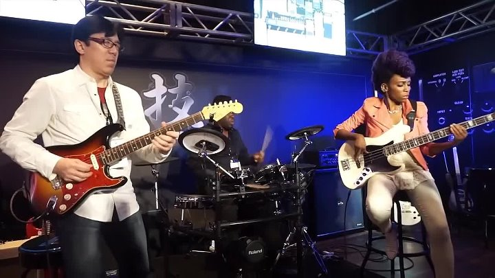 Tomo Fujita Funky Fusion Trio feat Nik West and John Blackwell at Roland Booth, NAMM 2016