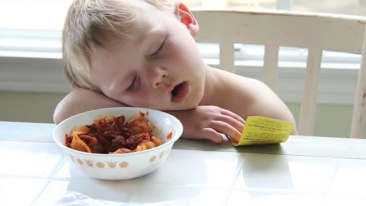 Boy Sleeping at Dinner Table after First Day of School