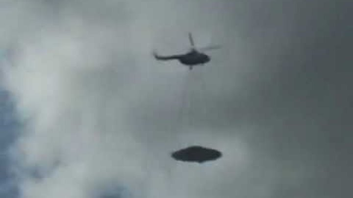 Russian helicopter pulling a UFO ?