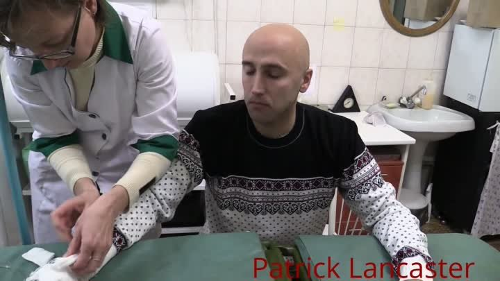 Interview with Graham Phillips at hospital after being hit by Ukraine mortar shrapnel near Donetsk