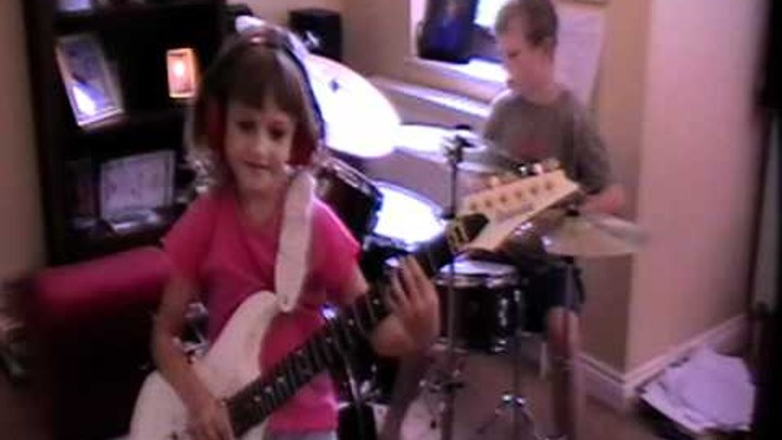 8 year old Zoe Thomson messing about with her brother Alex playing Muse - Knights of Cydonia